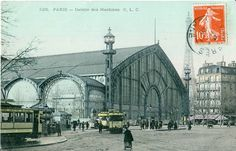 "Belle Epoque Trams stopping in front of the Pavilion of Machines (La Galerie des Machines), an exhibition hall constructed for the Exposition universelle de Paris in 1889 by Charles-Louis Ferdinand Dutert. It was demolished in 1909. Note the new"" Eiffel Tower in the background."