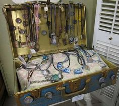 don't love the execution, but using a vintage suitcase for jewelry storage is a good idea.