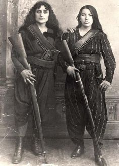 Armenian female fighters against the Ottoman Turks, c. 1895. Note the huge revolver tacked in the belt of the woman on the left. Both fighters hold their rifles with muzzle to the ground, a widespread manner in those days (but not conducive to safety since this is a good way of picking up dirt and other foreign objects from the ground, which could cause serious problems during firing).