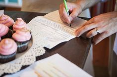 What better to watch over your marriage certificate signing than a pink-frosted cupcake? Nothing, we say! Congrats Kari & Ben | photo credit Priscilla Thomas Photography #weddingcupcakes #cupcakedownsouth