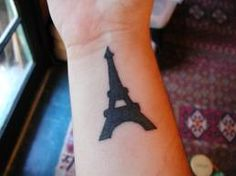 although I'm not particularly a fan of Paris, this Eiffel Tower tattoo is cool!