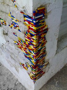 Artist repairs crumbling architecture with Lego.