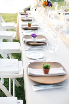 tiny potted plant or flower at each place setting, photo by Yeliz Atici http://ruffledblog.com/turkey-destination-wedding #weddingideas #reception #favors