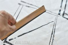Easy as 1-2-3! Create your own curtains with a wood shim stamp and a little paint. Click through to see the final result from Mandi of Vintage Revivals! || @Mandi Gubler stamp curtain, paint, shim stamp