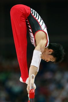 JULY 30: Kazuhito Tanaka of Japan competes on the parallel bars in the Artistic Gymnastics Men's Team final on Day 3 of the London 2012 Olympic Games at North Greenwich Arena on July 30, 2012 in London, England. (Photo by Streeter Lecka/Getty Images)
