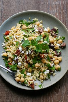 This Mediterranean Millet Salad is a healthy vegetarian side dish or main course filled with chickpeas, sun dried tomatoes, kalamata olives, fresh parsley, and goat cheese.