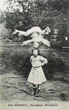 French postcard dated 1900 that depicts two young children who worked as acrobatic performers with a traveling circus.