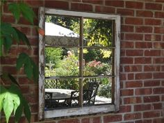 Old window with mirrow.  Great idea to brighten a covered patio!