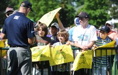 Jim Furyk signs autographs near the driving range during Monday's practice round of the 2012 Masters Tournament at Augusta National Golf Club on April 2, 2012, in Augusta, Ga. http://www.Augusta.com