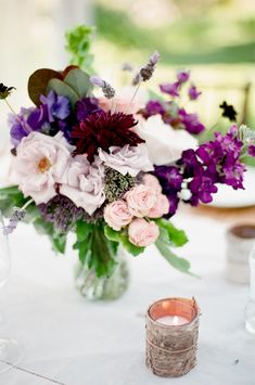 Mixed pinks and purple colors for Centerpiece | Very Natural - On SMP: http://www.StyleMePretty.com/2013/01/18/colorado-mountainside-wedding-from-sara-hasstedt/ Photography: Sara Hassted