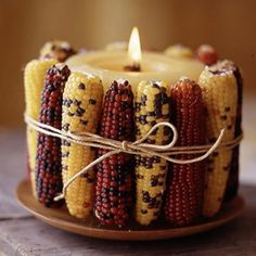 Candles wrapped with corns - DIY: Autumn Decoration and Centerpiece Ideas