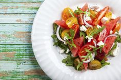 Make the best of summer with this recipe for watermelon and heirloom tomato salad! #recipe #healthysalad #tomatoes #summer