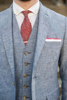 Blue linen suit with red details.