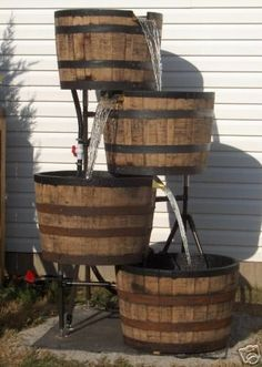 recycled whiskey barrels made into a fountain.