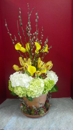 Design for a floral show including hydrangea, pussy willow, yellow callas and some fun tulips!