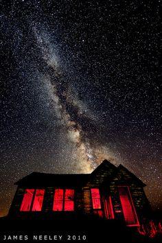 The old Swan Valley school house under Milky Way, Idaho