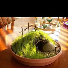An Easter experiment. Rebuilding Jesus' tomb. Using grass seed, river rocks, potting soil, and a buried flower pot for the tomb and stick made into crosses, remake His tomb. Use a spritz bottle to water the grass through the day for seven to ten days til it sprouts. Use the grass seed liberally.
