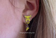 Hey, I found this really awesome Etsy listing at http://www.etsy.com/listing/164057864/pikachu-pokemon-clinging-earrings