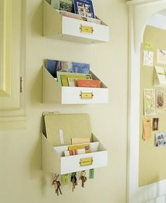 Although these sorters are usually seen ondesks, hanging them on the wall in multiples and adding hooks for keys is inspired.