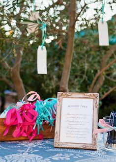Wishing tree: guests write wishes on these little ribbon tags and hang them.