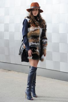 Mix textures by throwing a faux-fur patchwork vest over a blocked blazer