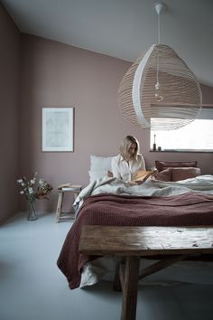 Warm, earthy, muted tones in this Scandinavian bedroom with raw, natural finishes #bedroomdecor #bedroomideas #scandinavianbedroom #mutedtones