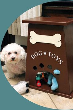 The Dog Toy Box - Dogs can get them out themselves through the bottom, and when you put them away it will automatically rotate your puppys toys. Such a good idea!