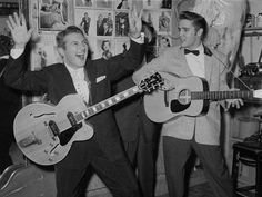 dueling um guitars - liberace and elvis