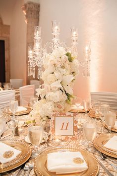 Designed by Dure Events. Florals by Keisha's Kreations. Photo by lulu lopez. http://munaluchibridal.com/white-and-gold-themed-wedding-in-houston-by-lulu-lopez/
