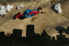 Great idea for a backdrop/floordrop for a super hero flying scene. clever use of live feed video could allow kids to act out impossible scenes like flying, walking on walls, falling up etc... Optical illusion and full body engagement, a bit of mental gymnastics and some simple technology could make great theatrical fun.