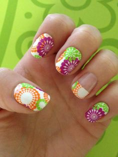 Colorful Modern Flower Design    It's BUY 3, GET 1 FREE! One sheet is 15.00 and has enough sheilds to do 2 or 3 sets of nails. They last 2-3 weeks on fingers and 4-6 on toes!