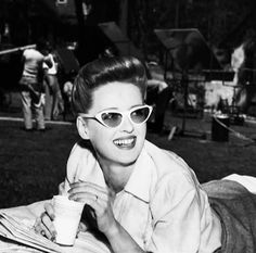 """Bette Davis, relaxing on the set of """"Now, Voyager"""""""