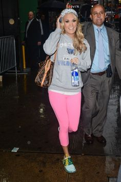 Spotted: Carrie Underwood sports a hot-pink look in rainy New York on Nov. 1