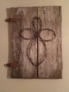 Old barn door and barn wire cross