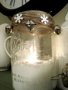 Use Epsom salt as filler. It looks like a candle sitting in snow in the winter