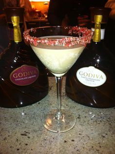 this was the best drink ever! Godiva Chocolate liquer, Stolis Vodka, candy cane mint on the rim, martini shaker, yum! #holiday #drink ideas #Godiva #entertaining. #pmevents