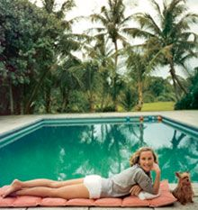 Socialite Alice Topping poolside in Palm Beach, circa 1959. Photograph by Slim Aarons/Getty Images/Courtesy of Assouline.