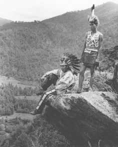 Indians of North America; National parks & reserves; Scenic overlooks; Clothing & dress Place: Great Smoky Mountains National Park (Tenn.) Description: Two Cherokee Indians in traditional costume posed on rock outcropping overlooking valley. Date: 5/30/1939 Collection: Dept. of Conservation Photograph Collection