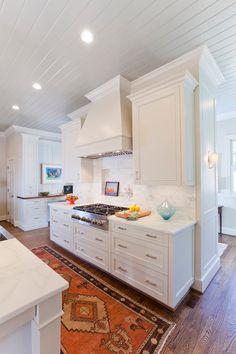 wood flooring, dream kitchen, range hoods, oriental rugs, white cabinets
