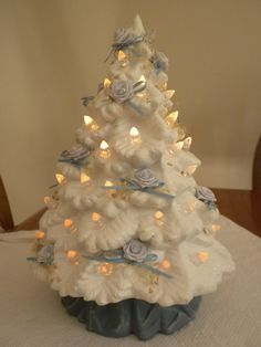 vintage ceramic Christmas tree, white with white lights, 8 inches. $32.00, via Etsy.