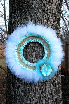 "Aqua (Turquoise Blue) & White Tulle Wreath, w/ Pearl and Burlap Accents, 15"" Diameter. $25.00, via Etsy."