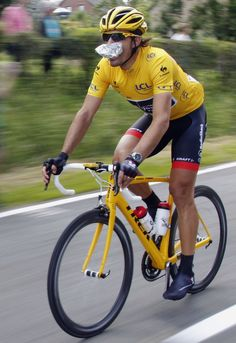 """Radio Shack-Nissan rider and leader's yellow jersey Fabian Cancellara of Switzerland eats as he cycles during the first stage of the 99th Tour de France cycling race between Liege and Seraing, July 1, 2012. REUTERS/Stephane Mahe"" #letour #TdF #cycling"