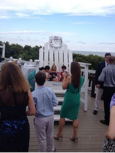 Candid: mom of the groom on our famous big chair at the Grand Pavilion @WildDunesResort #wedding #wilddunesweddings Charleston, SC