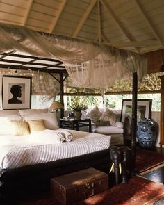 Love the mosquito netting - very Out of Africa.