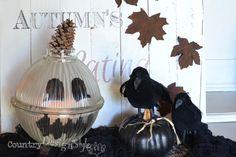 pumpkin from chandelier globe http://countrydesignstyle.com #pumpkin #fall