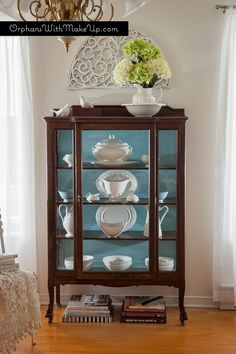 A wonderful compromise leads to stunning results! Orphans With Makeup shares this beautiful china cabinet finished with a blend of Provence, Old White & Louis Blue Chalk Paint® decorative paint by Annie Sloan on the inside while keeping the exterior a lovely stained wood! chalk paint, china cabinets, paint furnitur, chinacabinet, old china cabinet, curio cabinets