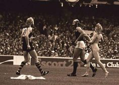 Bruce Doull pursued by a streaker during the 1982 Grand Final.