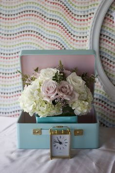 Clever #babyshower decor - love having the flowers tucked in a cute vintage suitcase
