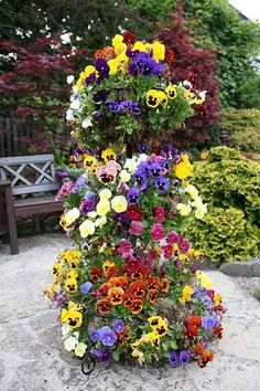 National Garden Competition, England - love this ideas - stack large flower pots that get slightly smaller as you go up and plant away - pansies in spring, petunias in summer, mums in fall............