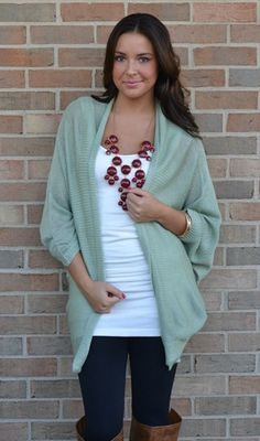 I have a zillion of these lazy sweaters--love the necklace and the tank underneath sweater, statement necklaces, color combos, fall looks, casual looks, brown boots, bubble necklaces, lazy fall outfits, fall womens outfits